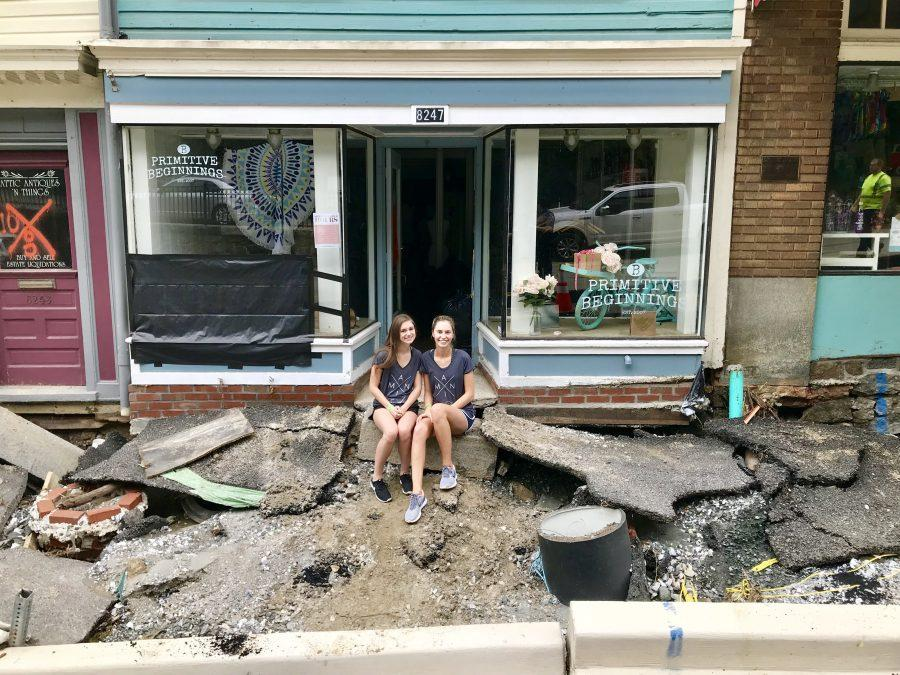 Two Primitive Beginnings employees, Samantha Kelley and Elizabeth Milano, sit perched on the front step after returning to the destroyed store to begin recovery. Photo contributed by Jeff Braswell.