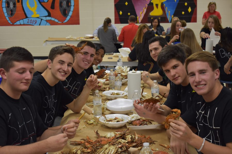 Current seniors enjoy the tradition of the crab feast.